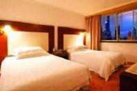 Huajun Suite Hotel Image