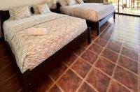 The Backyard Beachfront Hotel Image