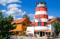 SATAMA Lodges & Ferienhäuser Image