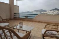 Apartamentos El Puerto Image