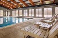 Timbercreek Inn & Suites Image